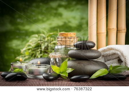 spa concept with zen basalt stones and massage oil