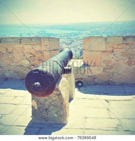 Old cannon in Santa Barbara fortress, Alicante, Spain.  Instagram style filtred image