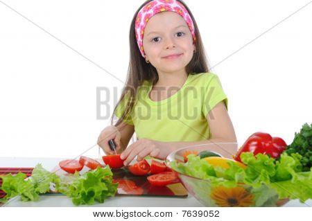 Little Girl Cut Fresh Vegetables.
