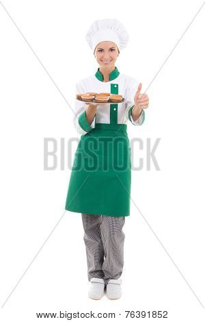 Happy Chef Woman In Uniform Holding Tray With Muffins And Thumbs Up Isolated On White