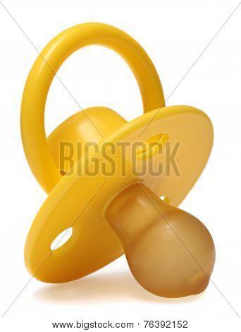 yellow  baby's dummy isolated on white background