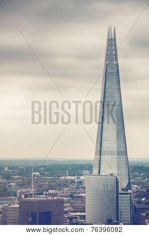 External view of the Shard in London on a cloudy day with copyspace in an architectural and travel concept