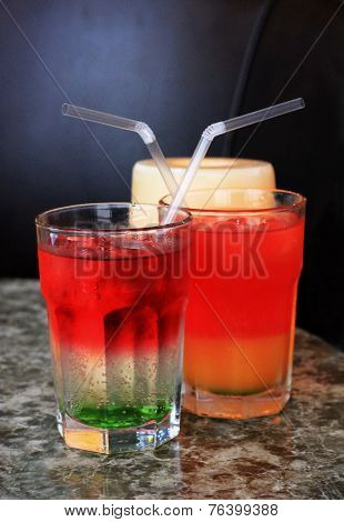 Glass Of Drink With A Straw On The Marble Table
