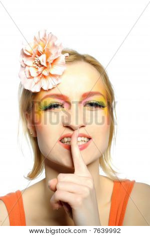 Concept Of Summer Fashion Woman With Creative Eye Make-up In Yellow And Green Tones Keeping Silence.