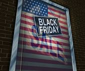 image of year end sale  - Black Friday holiday sale banner sign on a store window with an American flag reflection to celebrate the season to shop for low prices and discounts at retail stores offering special buying opportunities - JPG