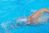 picture of swim meet  - health and fitness lifestyle concept with young athlete swimmer recreating  on indoor olympic pool - JPG