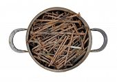 stock photo of saucepan  - Detail of the old saucepan full of rusty nails - JPG