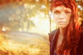 pic of freckle face  - beautiful woman with freckles and red long hair in fall park - JPG