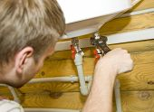 stock photo of boiler  - Plumber at work - JPG
