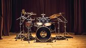 image of drum-set  - Modern drum set on stage prepared for playing - JPG