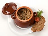 image of pot roast  - roast from pork with greens and a pomidorka in a brown clay pot - JPG