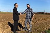 image of land development  - Land grabbing with a businessman and a farmer - JPG