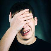 stock photo of sorrow  - The Sorrowful Teenager on The Dark Background - JPG