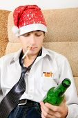 picture of teen smoking  - Teenager in Santa Hat with Bottle of the Beer smoking Cigarette - JPG