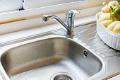 picture of sink  - Close up of kitchen faucet and sink - JPG
