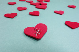 pic of stitches  - Red stitched broken heart and assorted hearts on blue - JPG