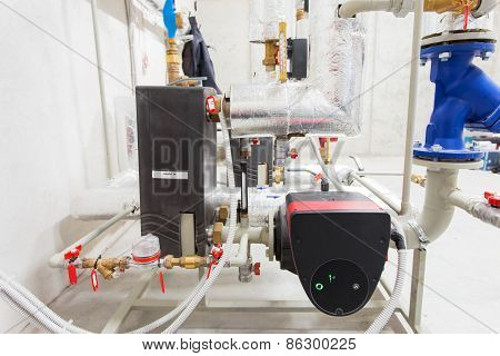 Pipeline installation and water pump in boiler room