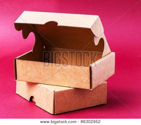 Carton boxes on a pink background