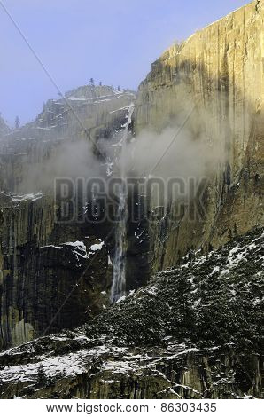 Winter scene in Yosemite with mist around the Bridalveil falls