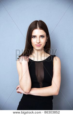 Young beautiful woman over gray background