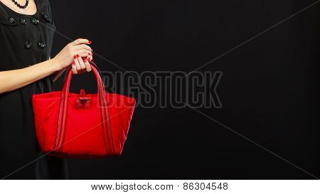 Woman Hand Holds Red Handbag