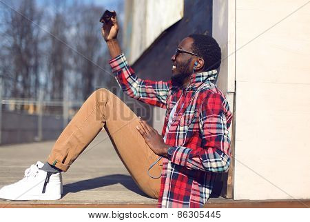 Fashion Lifestyle Photo Happy Young African Man Makes Self-portrait On The Smartphone Outdoors, Hips