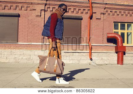 Street Fashion Concept - Handsome Stylish African Man Walks In The City