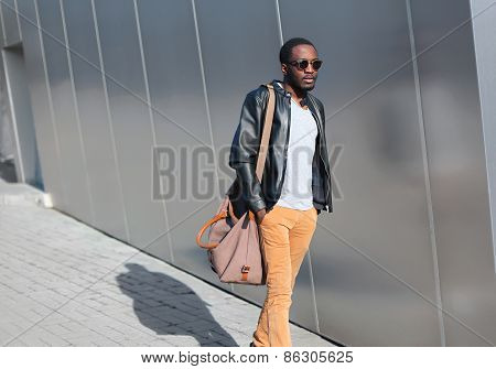 Street Fashion Concept - Handsome Stylish Young African Man Walks Evening In The City Against A Urba