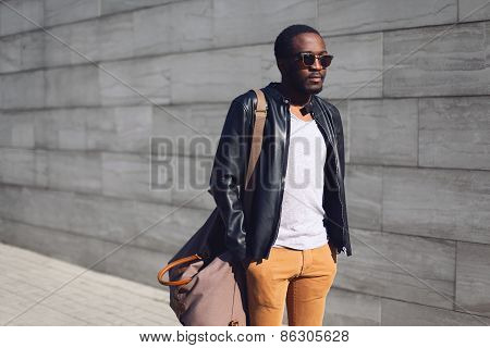 Street Fashion Concept - Stylish Handsome African Man Standing In The City Against A Gray Textured W