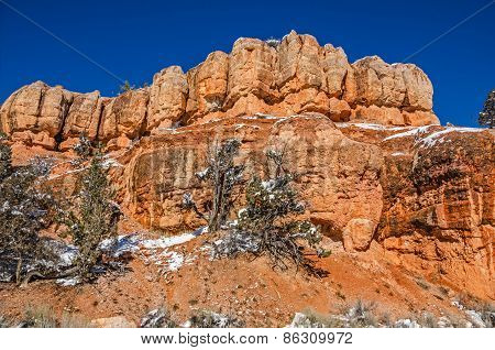Orange Rock Formations Against Blue Sky