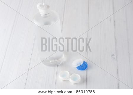 Contact Lenses Case And Solution On White Background