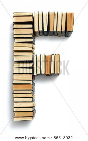 Letter F formed from the page ends of closed vintage hardcover books standing on a white background from a set or series of numbers