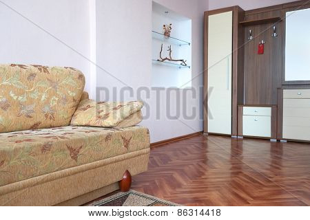The image of a wardrobe and sofa