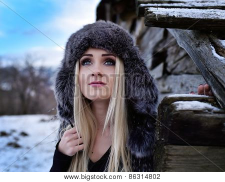 young pretty woman portrait outdoor in winter
