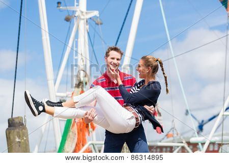 Couple enjoying vacation at German north sea ship pier