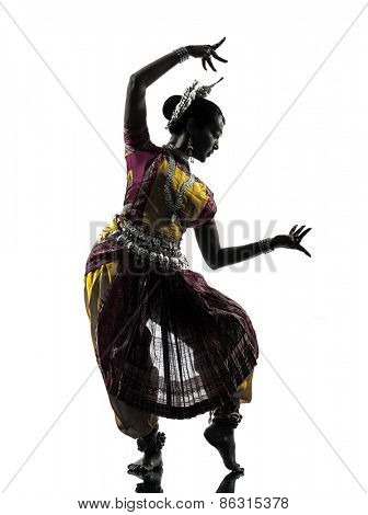 one indian woman dancer dancing in silhouette studio isolated on white background