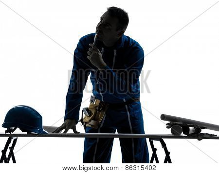 one  man construction Architect working plans silhouette in studio on white background