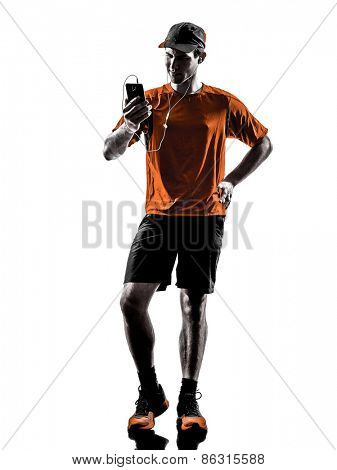 one young man runner jogger using smartphones headphones in silhouette isolated on white background