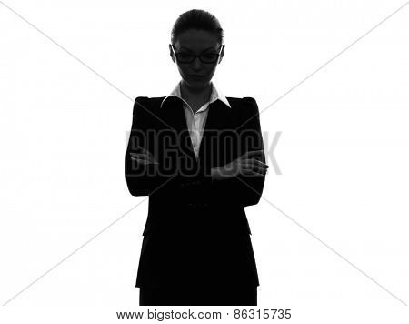 one  business woman arms crossed portrait in silhouette on white background