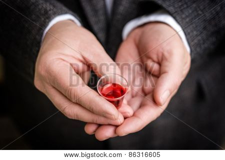 Hands holding Communion cup