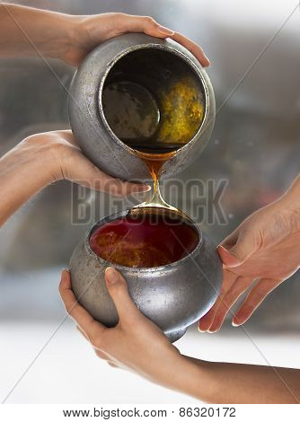 Honey, Two Old Pots And Four Woman's Hands