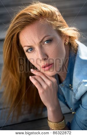 fashion portrait of strict red-haired girl