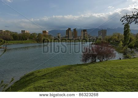 View to Vitosha mountain from lake in garden at quarter Drujba