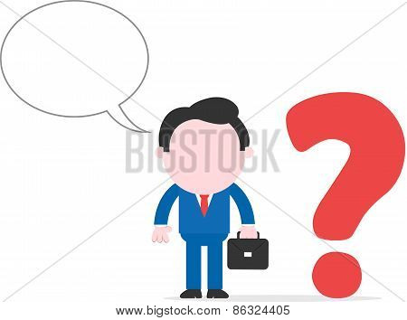 Businessman Beside Question Mark
