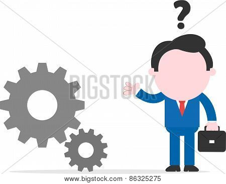 Confused Businessman Beside Gears