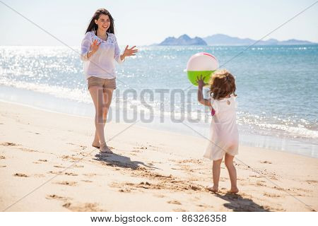 Little Girl Throwing Beach Ball