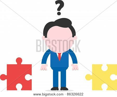 Confused Businessman Beside Seperate Puzzle Pieces