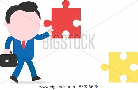 Businessman Walking And Holding Puzzle Piece