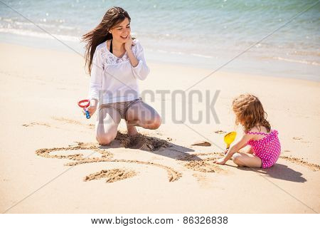 Drawing Together In The Sand