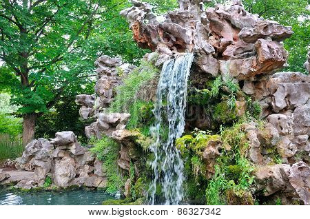 Small Waterfall In Beautiful Park
